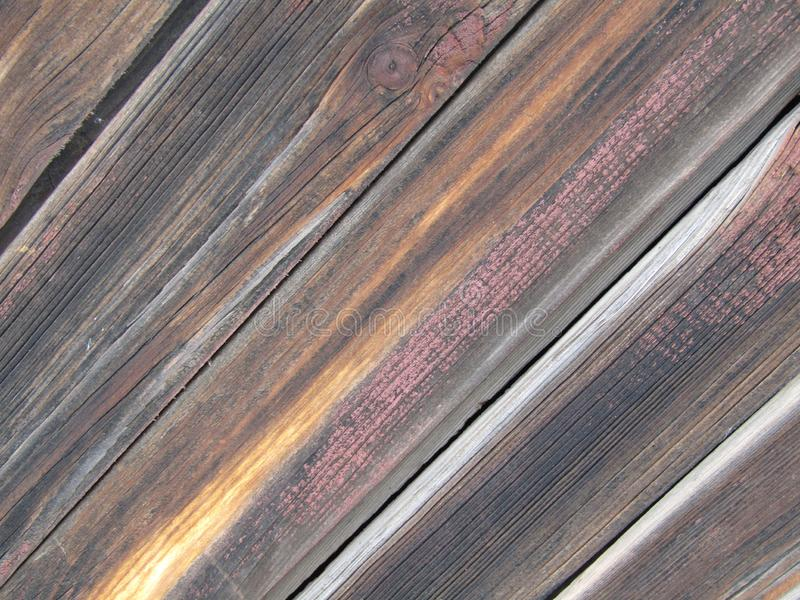 La bella struttura dei bordi di legno anziani, ha dipinto irregolarmente diagonalmente immagine stock