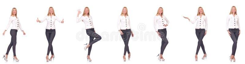 La belle femme dans des pantalons d'isolement sur le blanc photo libre de droits