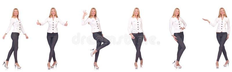 La belle femme dans des pantalons d'isolement sur le blanc images libres de droits
