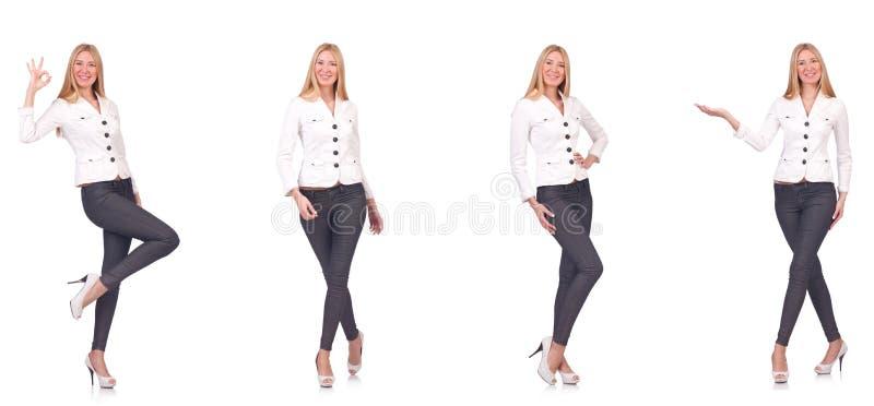 La belle femme dans des pantalons d'isolement sur le blanc images stock