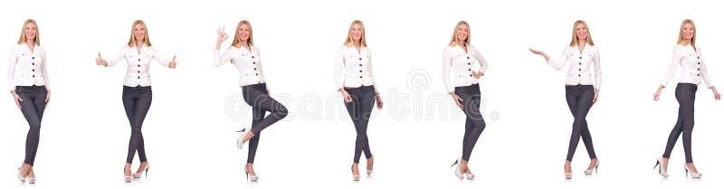 La belle femme dans des pantalons d'isolement sur le blanc photos libres de droits