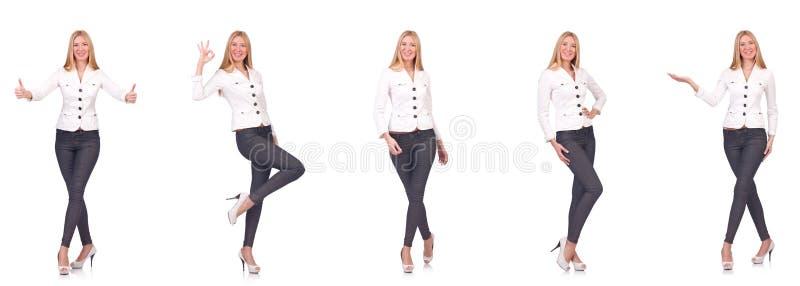 La belle femme dans des pantalons d'isolement sur le blanc photographie stock libre de droits