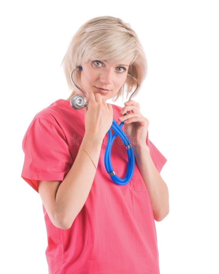 La belle infirmière dans le rose frotte image stock