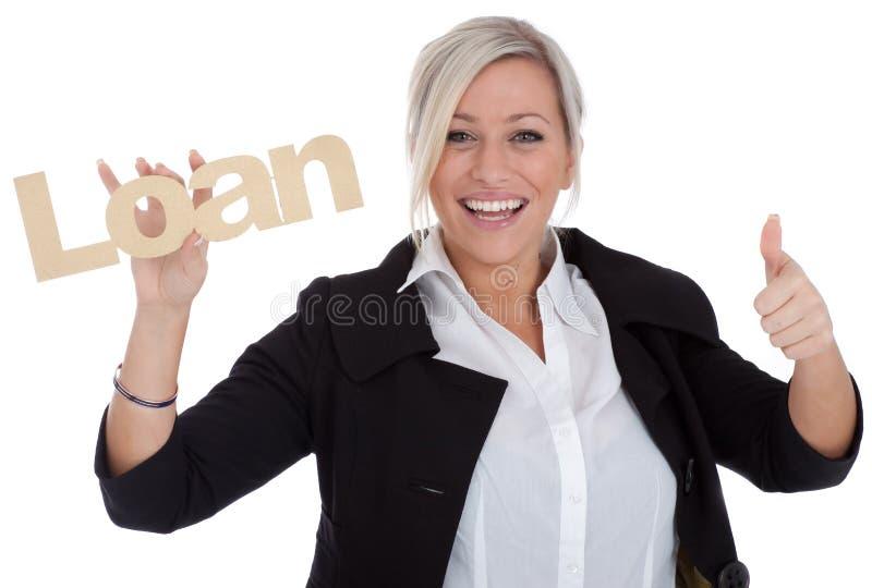 La belle jeune femme d'affaires est heureuse avec l'emprunt photos stock