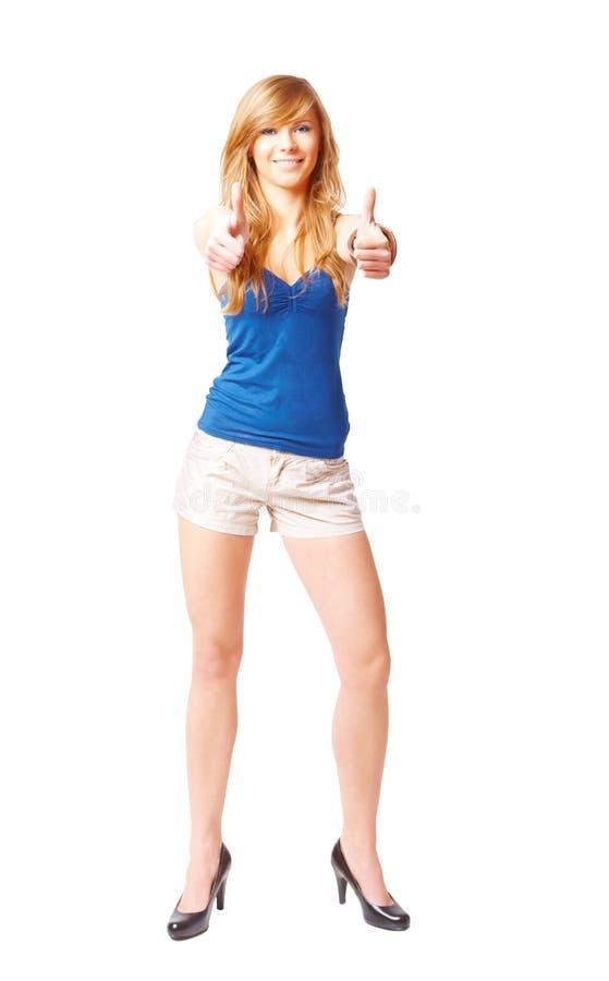 La belle jeune fille avec des pouces lèvent le signe photos stock