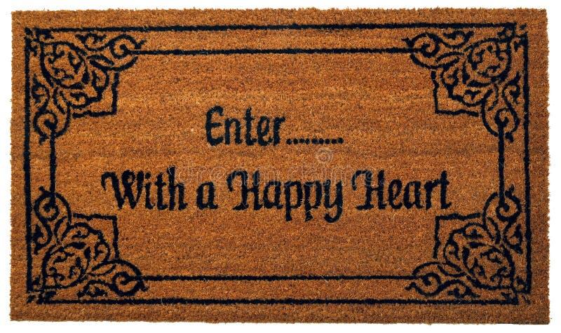 """La belle natte colorée de zute d'accueil de conception de motif avec """"entrent… avec le texte d'un coeur heureux """" images stock"""