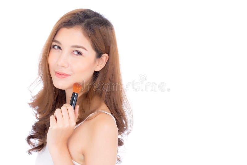 La belleza de la aplicación asiática de la mujer del retrato compone con el cepillo del ch fotografía de archivo