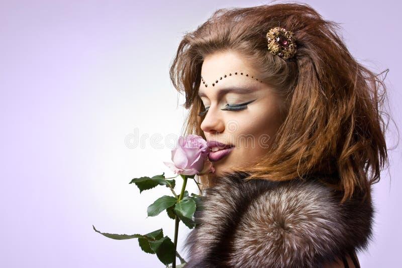 La bellezza con è aumentato fotografie stock