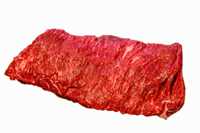 La bistecca di Bavette, o il ferro del fianco è su un fondo bianco immagini stock libere da diritti