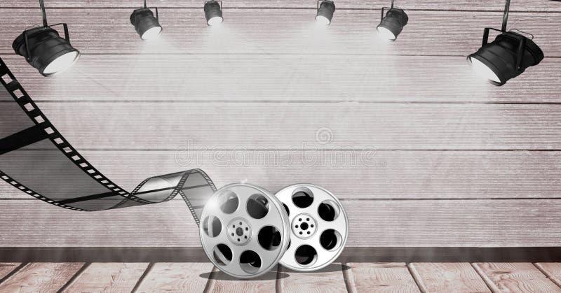 La bobina di film contro il punto si accende su fondo di legno fotografie stock