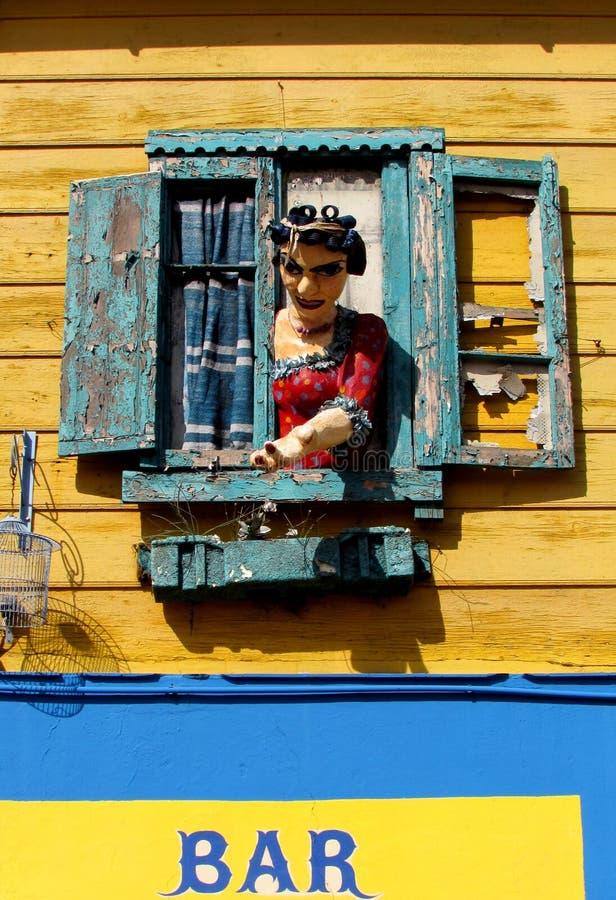 La Boca, Buenos Aires. Female figure in the window in La Boca, Buenos Aires stock images