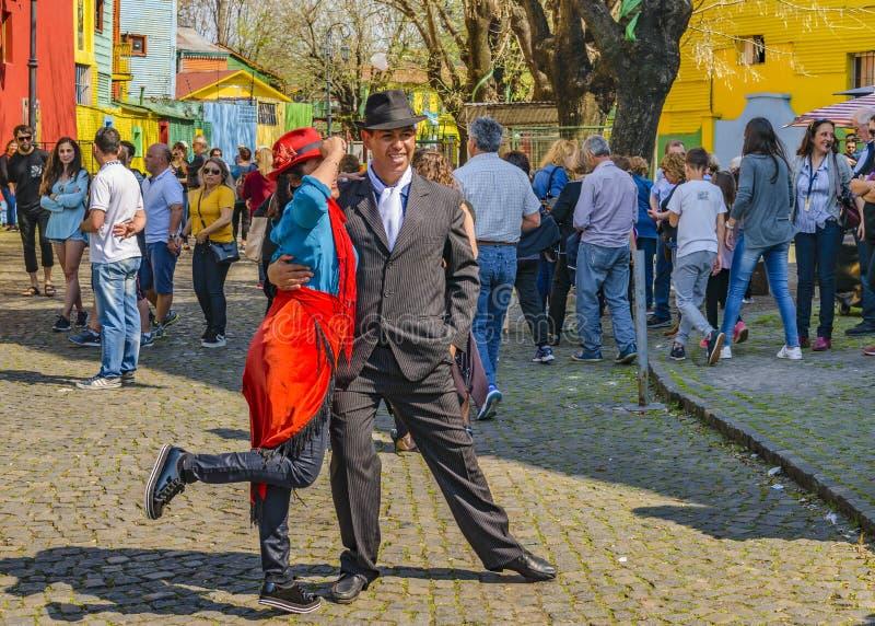 La Boca Neighborhood, Argentina. BUENOS AIRES, ARGENTINA, SEPTEMBER - 2018 - Couple of tango dancer posing for a photo at traditional caminito street at la boca stock photos