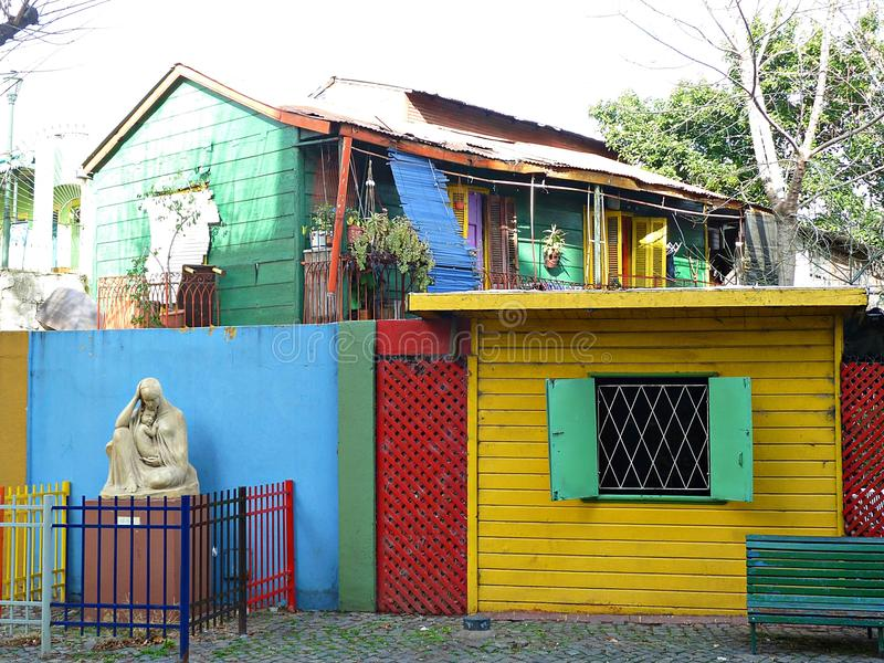 La Boca Street. Street view in La Boca Neighborhood, Buenos Aires, Argentina, showing multi-colored buildings, a sculpture of Madonna and Child, and apartment royalty free stock image