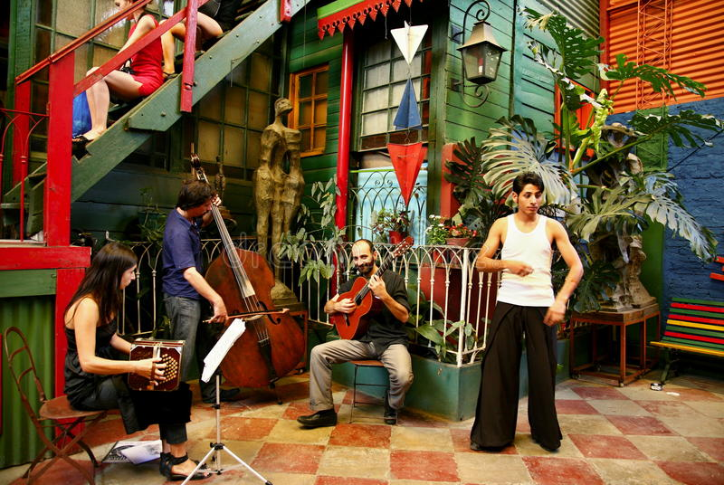 La Boca tango music band at Buenos Aires. La Boca is a popular destination for tourists visiting Argentina. Authentic music band helps people to feel music and stock photos