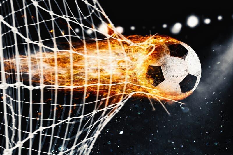 La bola de fuego del fútbol anota una meta en la red fotografía de archivo