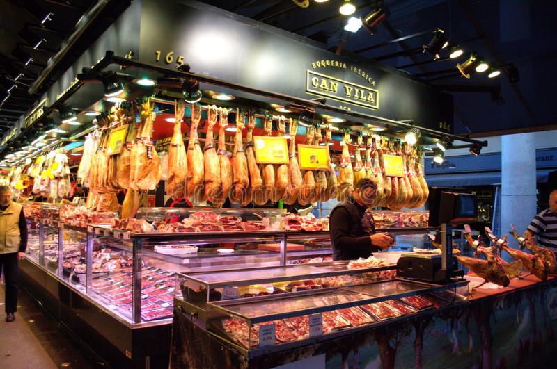Meat stall,Barcelona market. Spanish ham stall in famous La Boqueria market - one of the oldest markets in Europe.Barcelona,Spain.This cured, air-dried Spanish stock photos