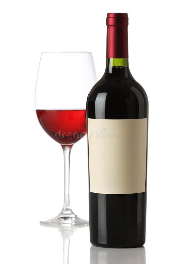 La botella de vino rojo con y vacia la escritura de la etiqueta imagen de archivo libre de regalías