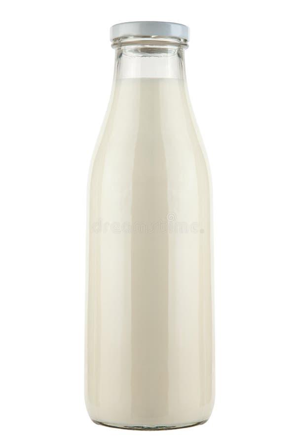 La bottiglia di latte isolata su fondo bianco immagine stock