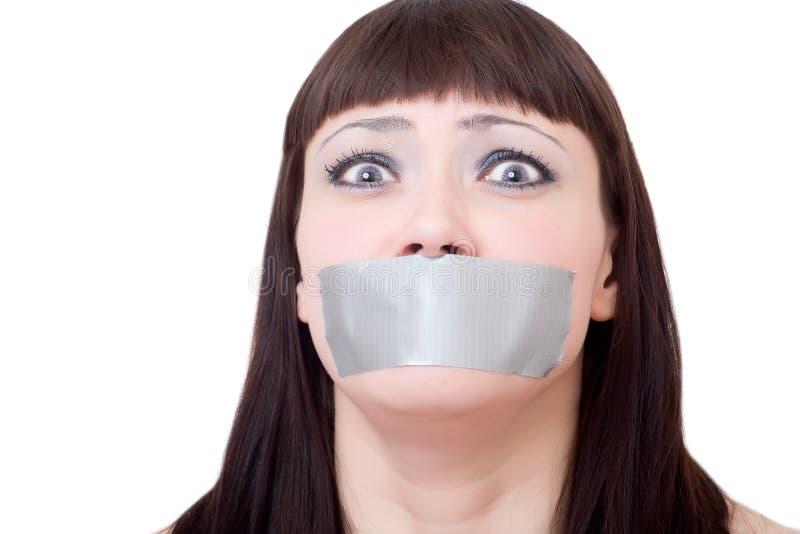 La bouche du femme scellée avec un écossais images libres de droits