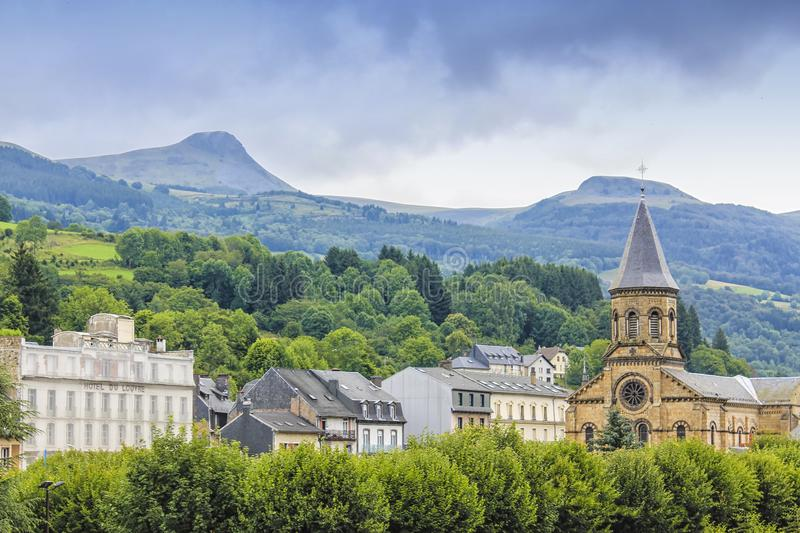 View over the town and volcanic surroundings of La Bourboule, Puy-de-Dome department in royalty free stock photos
