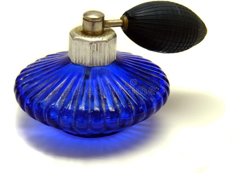 La bouteille bleue avec le perfum photographie stock libre de droits
