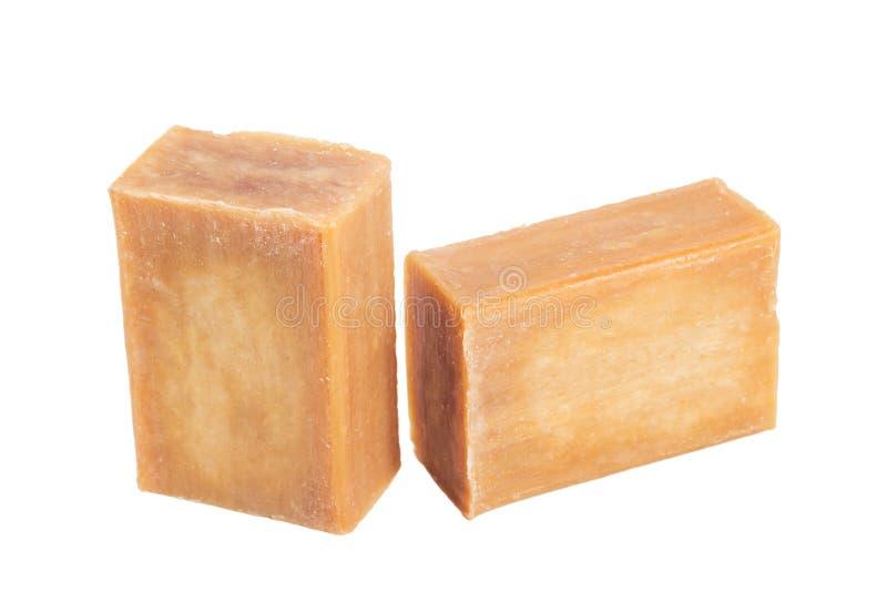 La brique deux du savon commun brun isollated sur le blanc photos stock