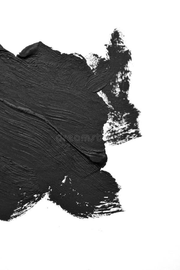 La brosse noire frotte des peintures à l'huile sur le livre blanc photographie stock libre de droits