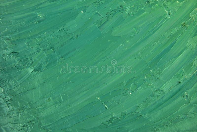 La brosse sale d'huile verte frotte le fond photo libre de droits
