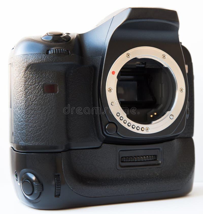 La cámara de Digitaces SLR con la lente y el apretón vertical de la batería aisló foto de archivo