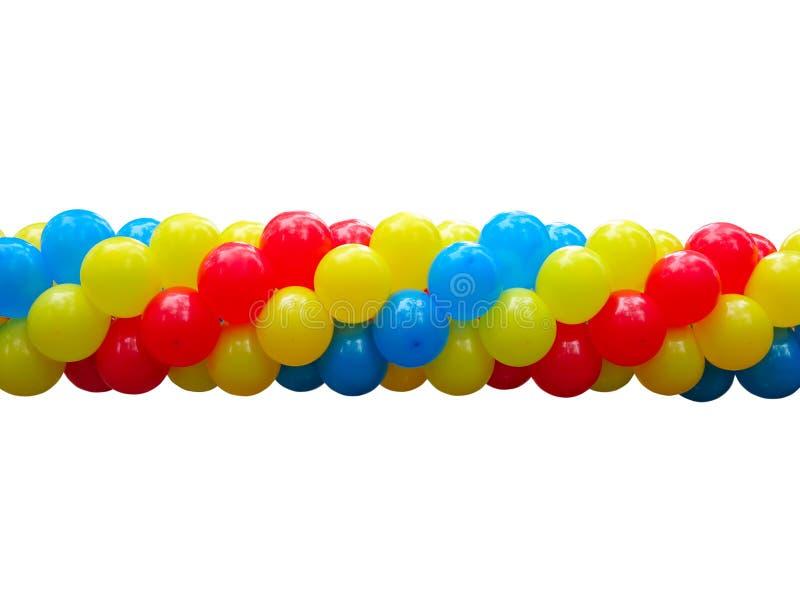 La célébration rouge, bleue et jaune monte en ballon dans la pile d'isolement photographie stock libre de droits