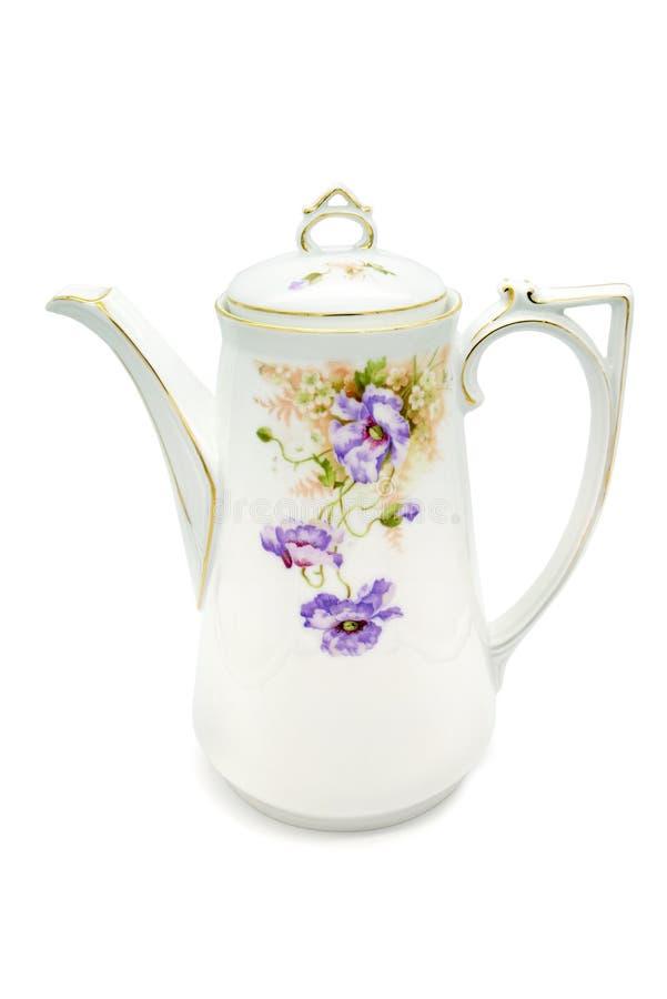 La caffettiera dell'oggetto d'antiquariato di tempo di Art Nouveau su bianco ha isolato il fondo fotografia stock libera da diritti