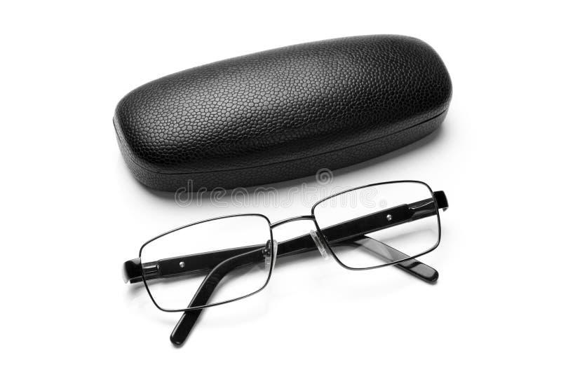 La caisse et les lunettes en similicuir noires de monocle metal in fine le cadre photo stock