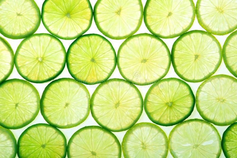 La cal verde rebana el fondo imagen de archivo