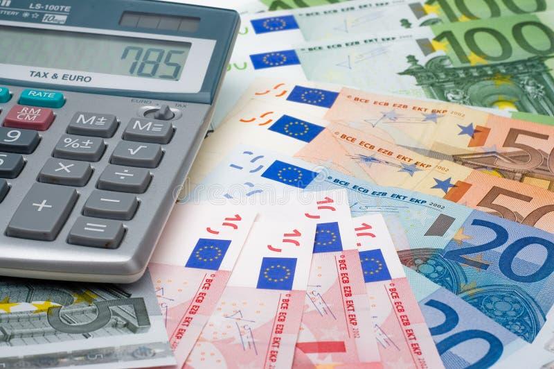 La calculatrice et les euro photographie stock