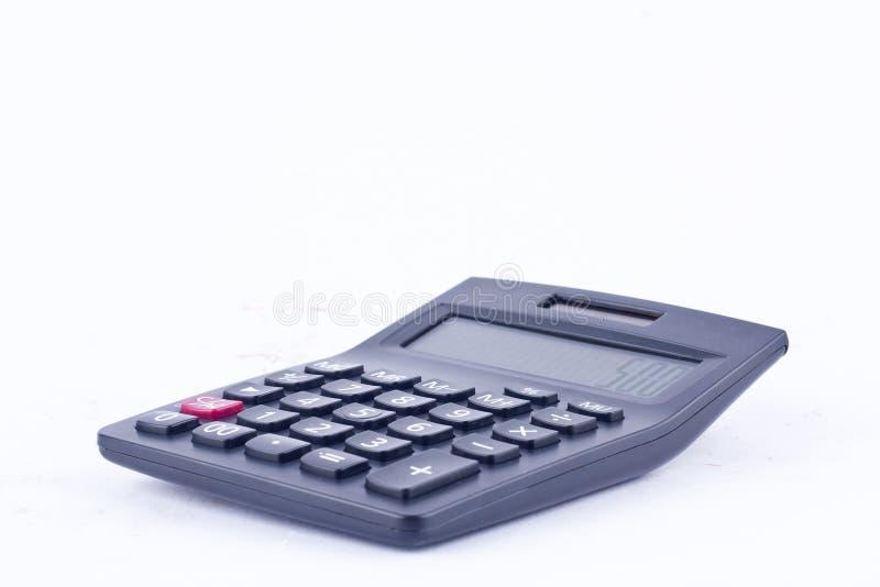 La calculatrice pour calculer l'anticipation commerciale de comptabilité de comptabilité de nombres sur le fond blanc a isolé la  photographie stock libre de droits