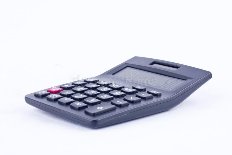 La calculatrice pour calculer la comptabilité de comptabilité de nombres financent l'anticipation commerciale sur l'avant blanc v images stock