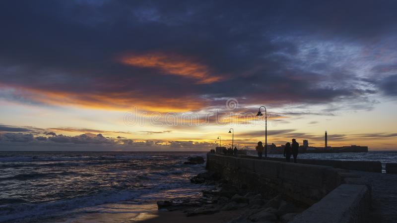 Dramatic Sky at the Walkway Cadiz Spain stock images