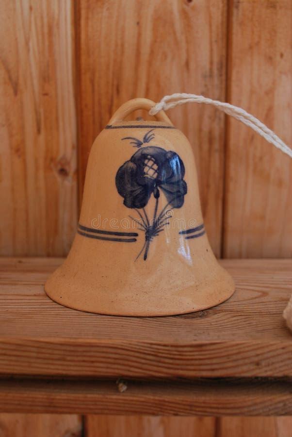 La campana con il fiore fotografia stock