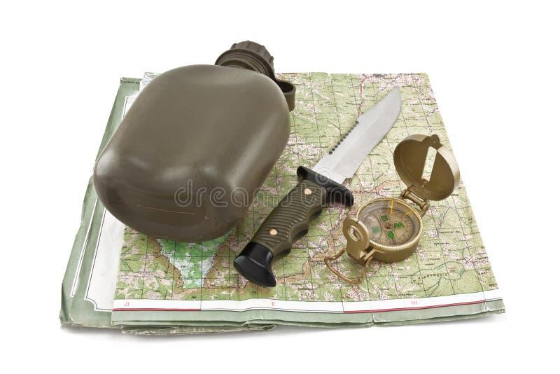 La cantina del ejército, un cuchillo y un compás están en la correspondencia imagen de archivo