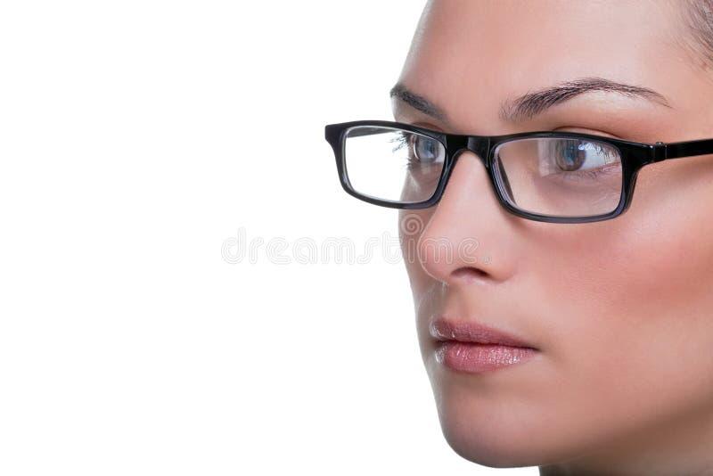La cara de Womans con los vidrios se cierra para arriba fotos de archivo