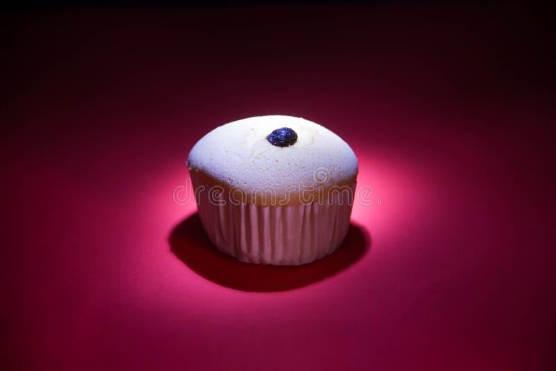 La caramella della tazza è sotto la lampada fotografia stock libera da diritti