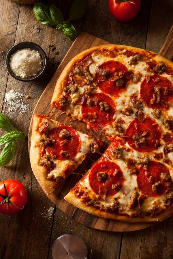 La carne casalinga ama la pizza fotografie stock