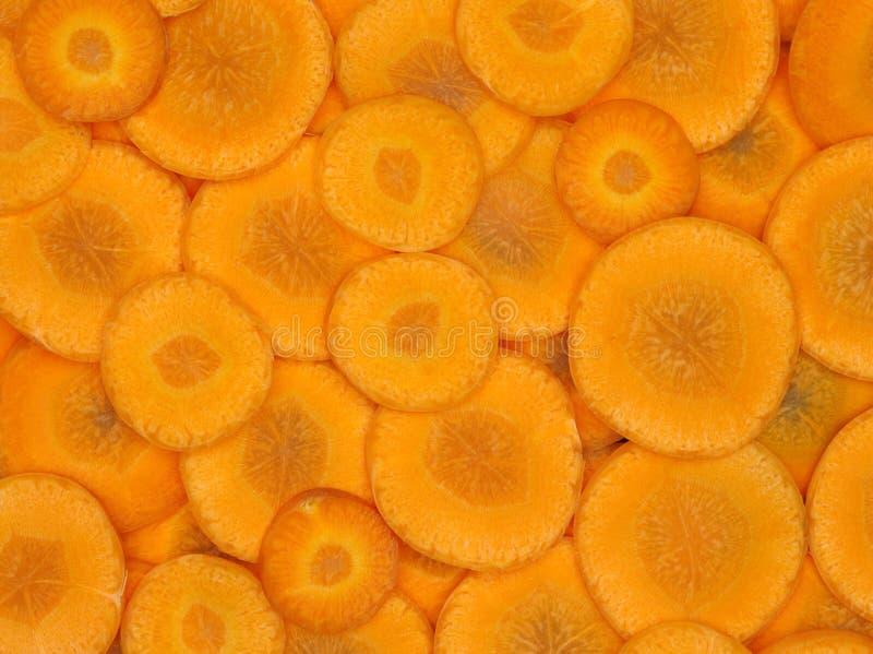 La carotte coupe en tranches l'orange image stock