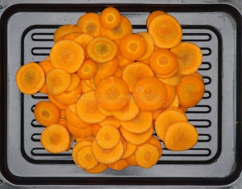 La carotte coupe en tranches l'orange photos stock