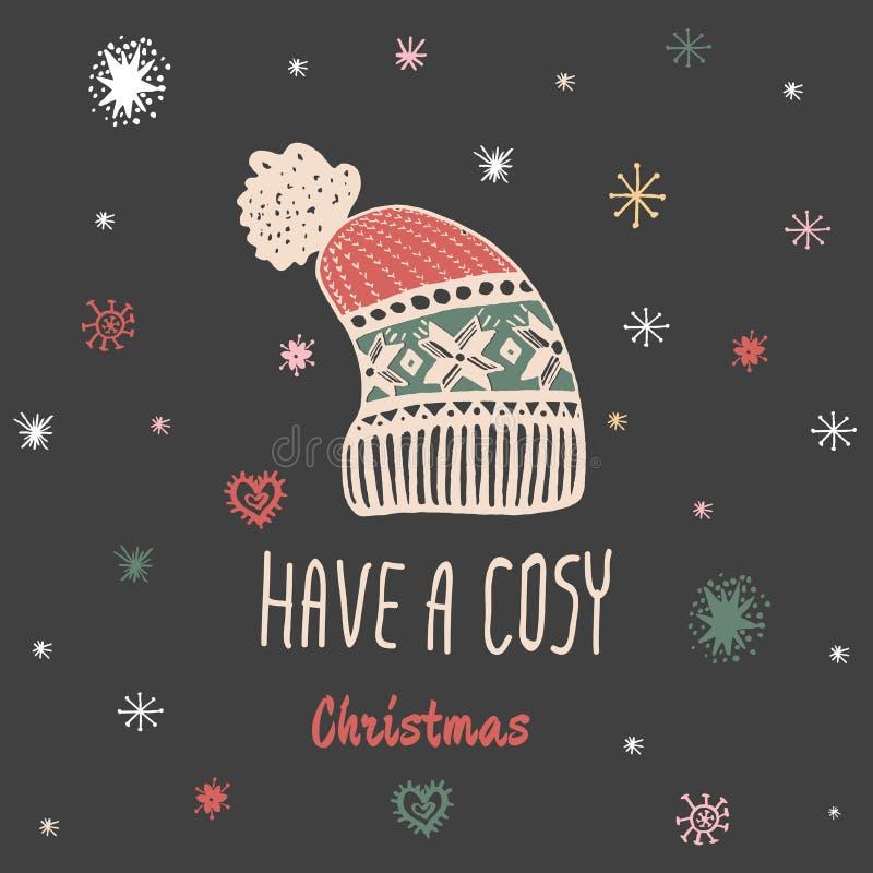 La carte de vintage de Noël avec avec le chapeau tricoté tiré par la main d'hiver et le texte 'ont Noël confortable' illustration libre de droits