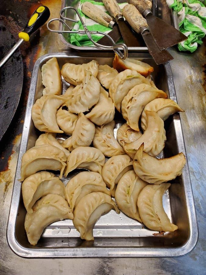 La casserole a fait frire des boulettes dans Macao photographie stock libre de droits