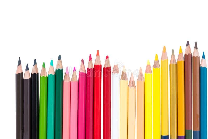 La cerca del lápiz del color arregla aislado foto de archivo
