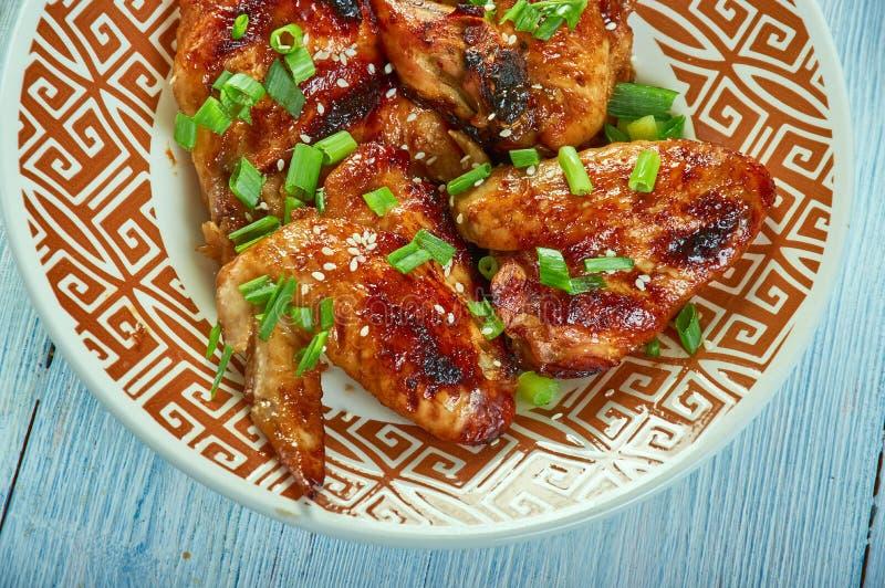 La cerveza coció las alas de pollo de Szechuan imagen de archivo