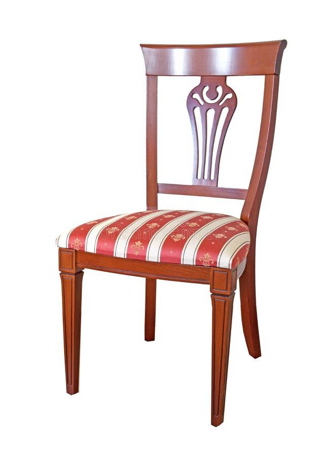 La chaise est faite dans le style classique à partir du bois et de la tapisserie d'ameublement rouges à partir d'une tapisserie images stock