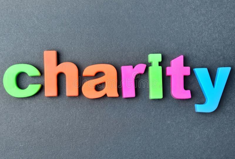 La charité de mot sur le fond photos libres de droits
